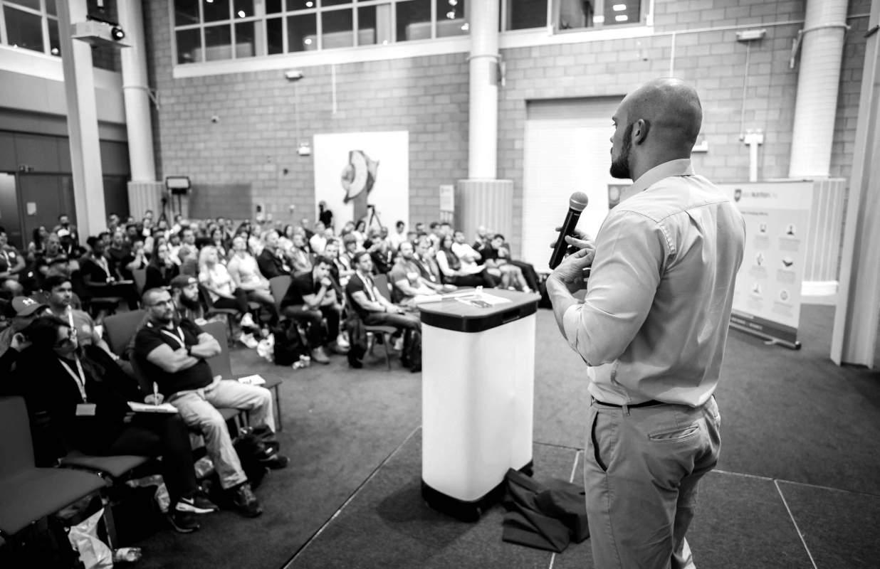 Martin speaking on tour